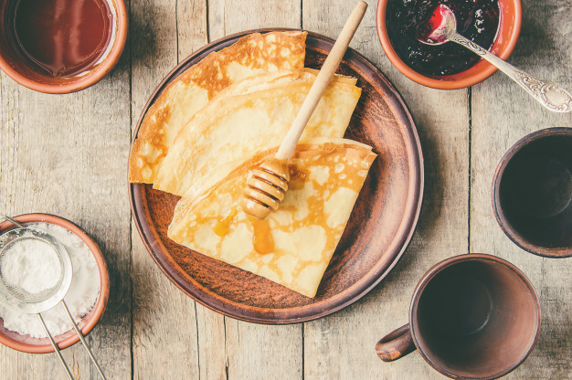 crepes-are-homemade-pancakes-selective-focus-food_73944-6212
