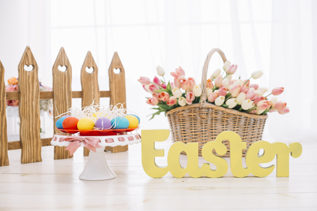 colorful-easter-eggs-tulips-basket-with-yellow-easter-text-wooden-desk_23-2148066250