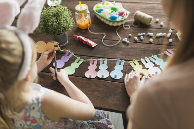 mother-daughter-cutting-bunnies-from-paper_23-2147760628